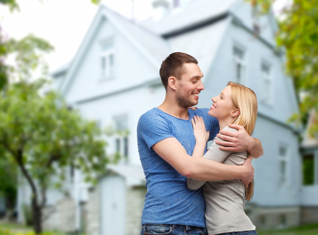 love, people, real estate, home and family concept - smiling cou